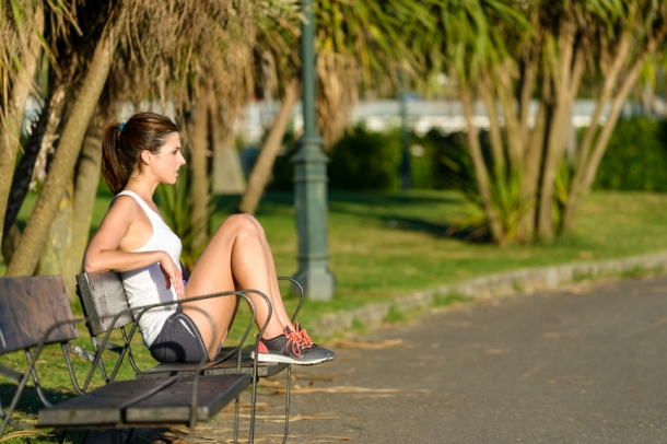 Healthy woman resting after running and exercising